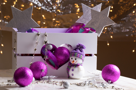 festive occasions: Christmas toys in wooden box on  table close-up. Christmas decorations with toys in box