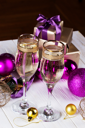 champagne and giftsnew year celebration christmas decorations with wineglass toasting with champagne