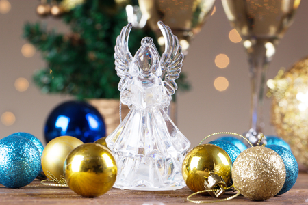 Crystal Angel On The Background Of Christmas Balls. New Year Decoration. Christmas  Ornaments Christmas