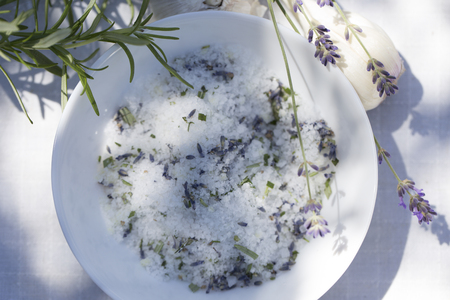 Herb salt with rosemary and lavender blossoms. Seasoning Herbs Mix Sea Salt and Spices Foto de archivo