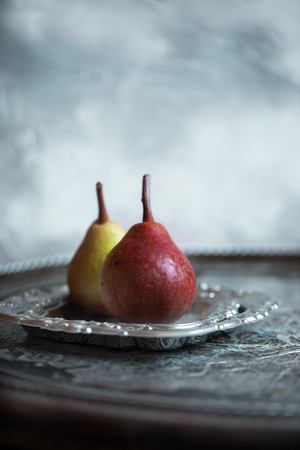 Artistic photo of two pears. Natural light. Stock fotó