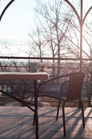 Rattan chair at the balcony. Beautiful outdoor patio with chair and table Reklamní fotografie