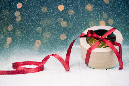 New Year or Christmas Gift Box with Red Ribbon.Snow Falling Effect.