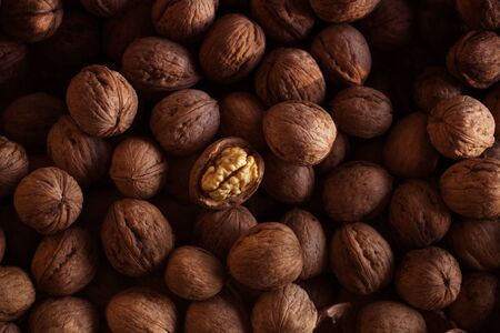 Heap of walnuts. Walnuts Background Texture. Background of fresh walnuts  Zdjęcie Seryjne
