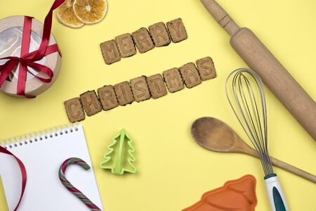 The words merry christmas are made of cookie letters.Wishes of Merry Christmas by the cookies with kitchen tools Zdjęcie Seryjne