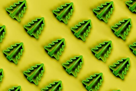 Christmas pattern with Christmas tree cookie cutter. Minimal holiday concept. Zdjęcie Seryjne