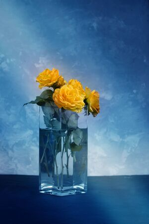 yellow rose in a glass vase. Yellow roses in vase on the table. Holidays and celebration concept
