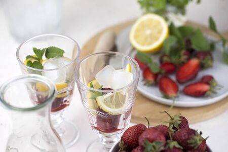 cold strawberry lemonade juice in the glasses with ice cubes. Summer refreshing drink. Cold detox water Banque d'images - 138363356