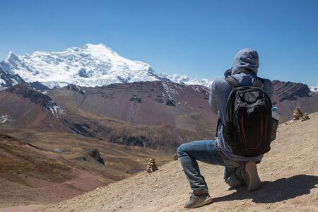 A photographer capturing the beautiful landscape