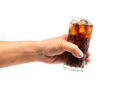 Glass of drink cola with ice in hand on white background