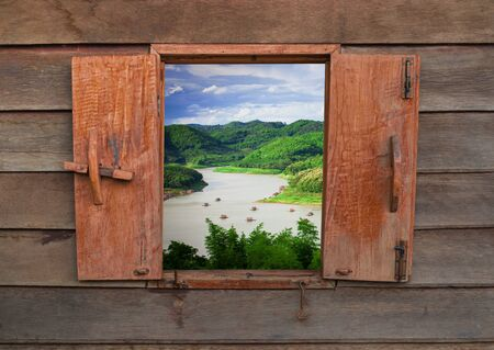 Old vintage wooden windows with mountain and river nature landscape Imagens
