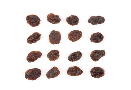 Organic dried raisins on white background, Top view of currant