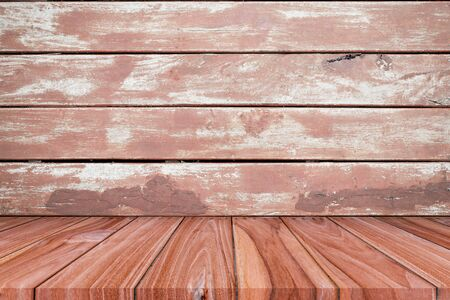 Empty shelf on brown wooden plank wall background. for montage of your product