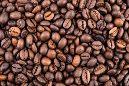 Roasted coffee beans texture used as a background 写真素材