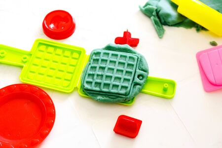 playing with modeling  clay. Montessori activity in the kindergarted. Colorful homemade modeling clay. Stock Photo