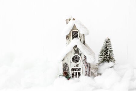 Stylish rustic Christmas background with snow house