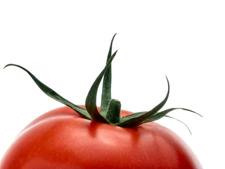 upper half: Upper half of ripe tomato isolated on white studio background