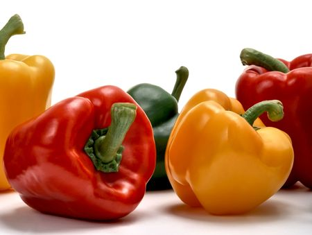 Red, green and yellow bell peppers isolated on white studio background Stock Photo - 5453369