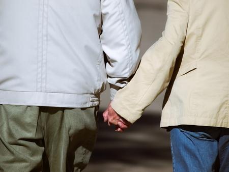 walker: Senior couple holding hands during walk