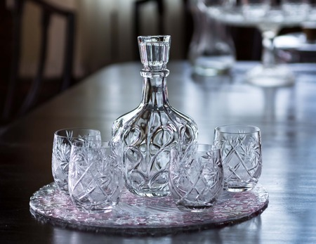 glasswork: Crystal water container and four crystal glass very clean and clear. Stock Photo