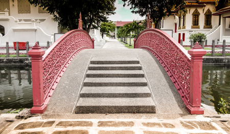 80 years: this iron bridge has been built for more than 80 years,the curved steel painted in red very beautiful. Stock Photo