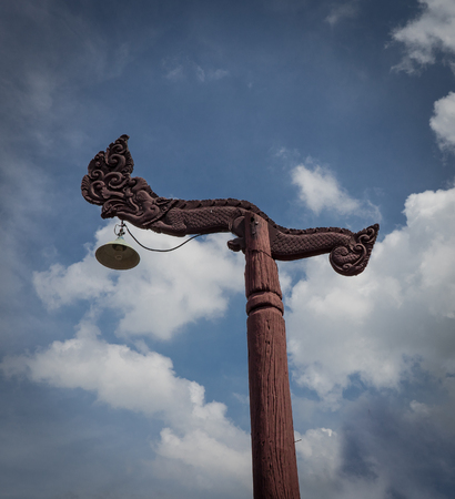 a typical wooden pole  with dragon on top Stock Photo