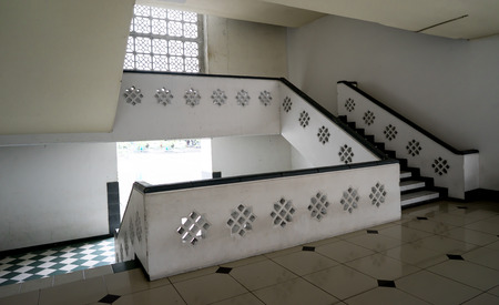 second floor: the white wall and white stair way of mosque in Indonesia