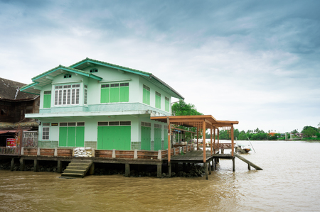 A beautiful wooden green house was built on the river side in Samutsakorn.