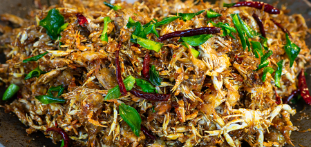 A lot of small crab fried with peper and chili in Thai style.
