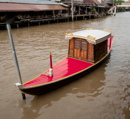 The Thai red boat made from wood in Thai style at floating market. Stok Fotoğraf