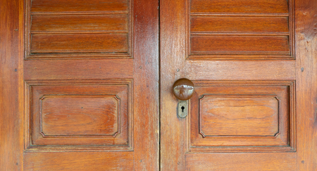Antique door made from teakwood old style of Thai house.