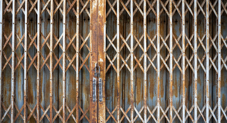 The old iron door become rusty because of the weather in rain season