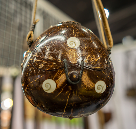 a small bag made from a coconut fruit
