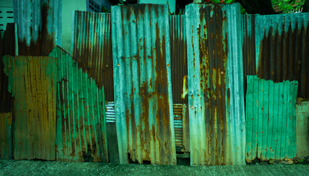 a typicle fence that made from corrugated iron Stock Photo