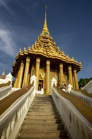 beautiful golden Pagoda under blue sky.