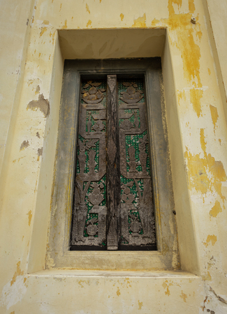 a very old wooden door of the very old temple age about 200 years