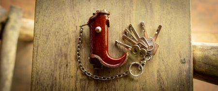 the cowboy boots keyring made from saw dust. Stok Fotoğraf