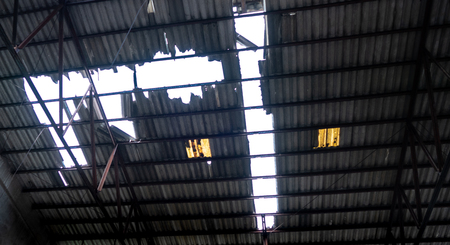 a big broken roof hold  after shut down the factory