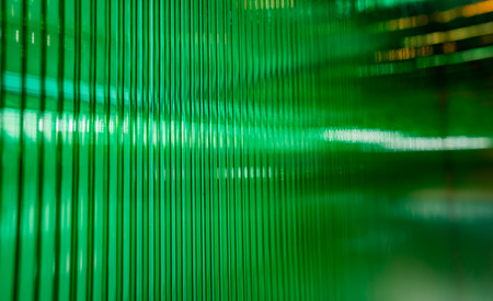 the out of focus of green plastic wall with some reflection Фото со стока