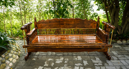 a beautiful wooden bench made by hard wood.