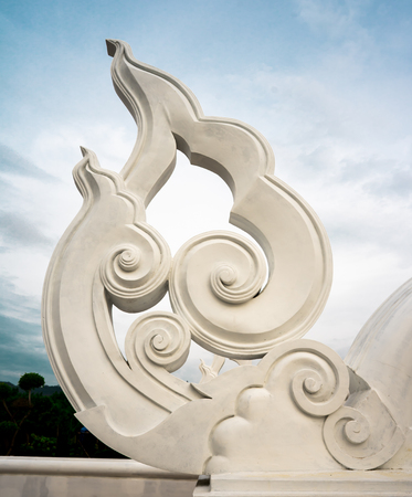 a huge white sculptured of stucco in Thai temple