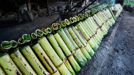 A traditional food made of glutinous rice,coconut milk and salt,cooked in the bamboo joints.