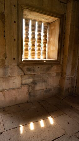 a big stone window inside of the main building of Pimai. Stok Fotoğraf - 132579805