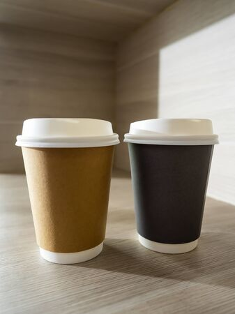two paper coffee cup on the gray table. Stok Fotoğraf - 132579819