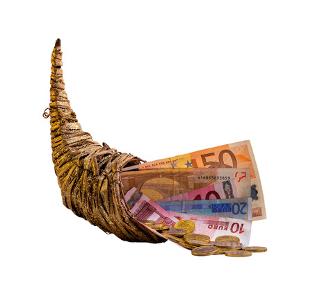plentifully: cornucopia - bills and change in a horn of plenty - isolated on white