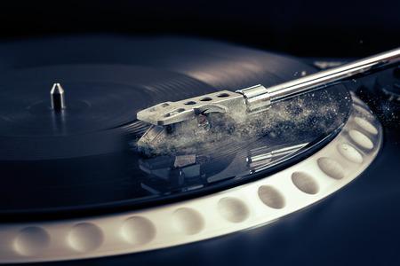 hi fi: vinyl laying on a record player - scratching the surface - nightclubbing, dj etc Stock Photo
