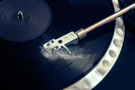 remix: vinyl laying on a record player - scratching the surface - nightclubbing, dj etc Stock Photo