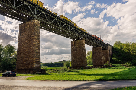 Pictorial view of a train bridge in Germany  fast train passing over Stock Photo