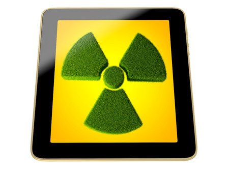 radioactivity: tablet with Radioactivity symbol made from grass on screen