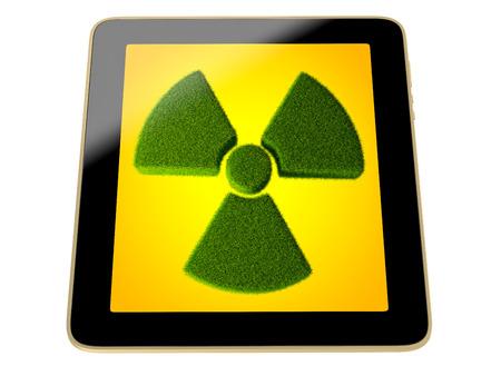 radioactivity: tablilla con el símbolo de la radiactividad hecha de hierba en la pantalla